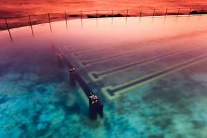 A view of the Bronte Beach ocean pool at dawn, located at the south end of Bronte Beach, a small but popular recreational beach on Nelson Bay.
