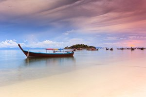 A long-tail boat at sunset on Ko Lipe, a small island surrounded by the Andaman Sea and located near the Tarutao National Park in southwest Thailand.