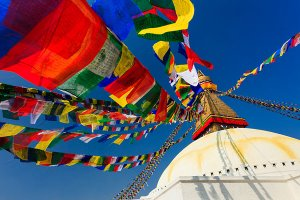 An ancient stupa surrounded by colourful prayer flags at the UNESCO World Heritage Site of Bodhnath, also called Boudha or Bouddhanath, one of the holiest Buddhist sites in Kathmandu.