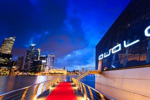 The exterior of the Avalon nightclub with the Financial District in the background, as seen from the Marina Promenade, part of the Marina Bay Sands complex.