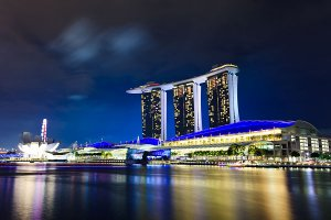 View of the Marina Bay Sands Hotel and the ArtScience Museum, located on the banks of the Marina Bay Reservoir in Singapore, as seen from Clifford Pier near Collyer Quay.