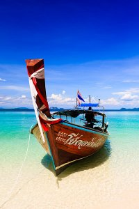 A long-tail boat on Ko Kradan, the most beautiful island in the pristine Trang Archipelago, surrounded by the Andaman Sea and located within the Hat Chao Mai National Park in southwest Thailand.