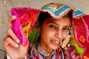 Portrait of a woman from the Marwada Meghwal Harijan tribe wearing traditional clothing and a large golden wedding ring through her nose in the village of Bhirendiara, located roughly 50km from Bhuj in the Kutch District.