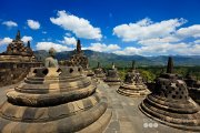 One of the world's truly great ancient monuments and the single largest Buddhist structure anywhere on earth, Borobudur - a Buddhist stupa and temple complex dating from the 8th century which is listed as a UNESCO World Heritage Site.