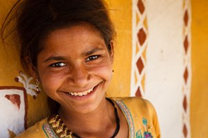 Portrait of a smiling Rajasthani girl, from a small village on the outskirts of Jaisalmer.