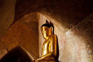 Large seated golden Buddha statue located inside the Sulamani Pahto, part of the Bagan Temple complex.