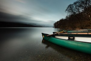 Canoes on Coniston Water, formerly known as Thurston Water, the third largest lake in the English Lake District National Park.