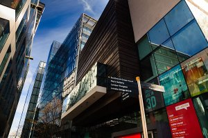 Modern architecture and signs situated around More London Place, located in the Southwark Borough of London.