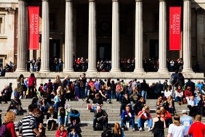 Tourists around The National Gallery, located in Trafalgar Square within the Westminster borough of London.
