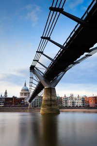 A view of St Paul's Cathedral and the Millennium Bridge which crosses the River Thames, located in the City of London.