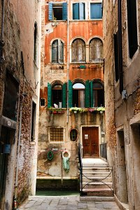 Historical buildings and narrow alleyways located along the length of the Grand Canal, located in the UNESCO World Heritage Site of Venice.