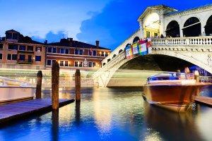 The iconic Rialto Bridge or Ponte di Rialto, the city's first bridge over the Grand Canal, located in the UNESCO World Heritage Site of Venice.