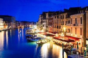 The view of the Grand Canal from the iconic Rialto Bridge or Ponte di Rialto, the city's first bridge over the Grand Canal, located in the UNESCO World Heritage Site of Venice.