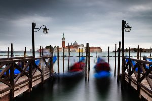 View across the Bacino di San Marco lagoon towards San Giorgio Maggiore, as seen from the Gondola station near Piazza San Marco, also known as St. Mark's Square, located in the UNESCO World Heritage Site of Venice.