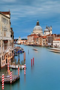 View of the Grand Canal as seen from the Ponte dell'Accademia bridge, with the Basilica di Santa Maria della Salute in the background, located in the UNESCO World Heritage Site of Venice.