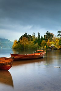 Boats on Derwent Water, as seen from Lakeside, located within the English Lake District National Park.